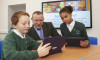 MD Drew Hendry at the new Samsung digital classroom at Merkinch Primary School. Pictured with pupils Jamie Hargreaves (10) and Caitlin Brobyn (11)
